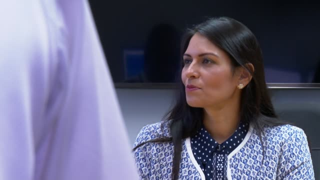 priti patel visit to metropolitan police central command centre and interview; england: london: lambeth: metropolitan police central communications... - desk stock videos & royalty-free footage