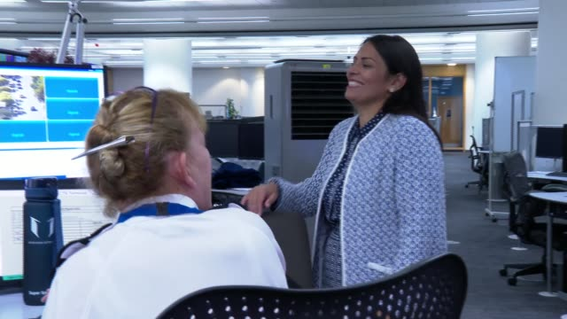 priti patel visit to metropolitan police central command centre and interview; england: london: lambeth: metropolitan police central communications... - office stock videos & royalty-free footage