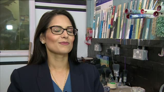 priti patel visits decorating apprentices priti patel interview sot on employment figures / growing the economy / job creation / 2 million new jobs /... - priti patel stock-videos und b-roll-filmmaterial