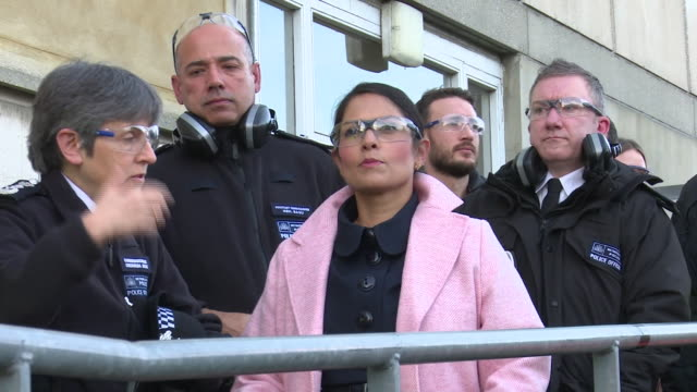 priti patel watching elite firearms officers taking part in a counterterrorism training exercise - priti patel stock-videos und b-roll-filmmaterial