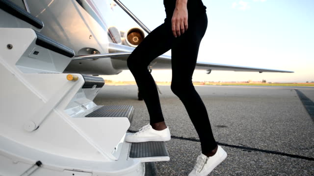 private airplane - boarding - female legs moving up stairs - private jet stock videos & royalty-free footage