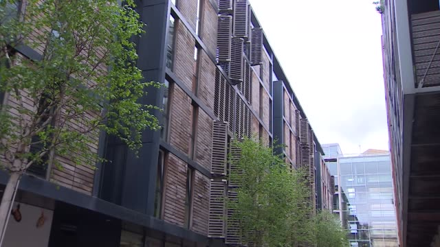 private block of flats covered in flammable wooden cladding - flammable stock videos & royalty-free footage