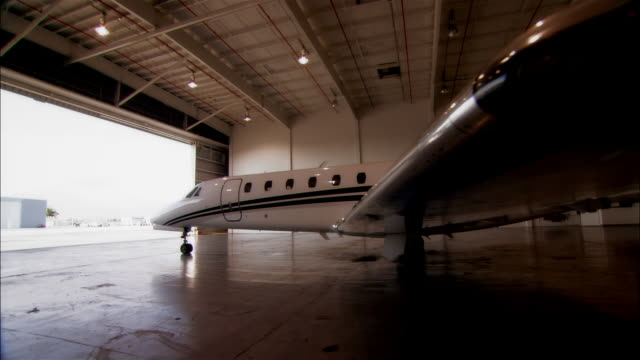 ws ds private jet in hangar at opa locka airport / miami, florida, usa - airplane hangar stock videos and b-roll footage