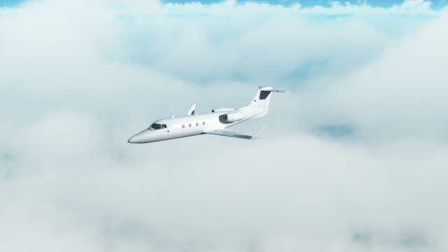 Private jet over clouds
