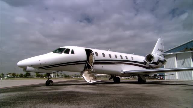 ws ds pan private jet parking outside hangar at opa locka airport / miami, florida, usa - airplane hangar stock videos & royalty-free footage