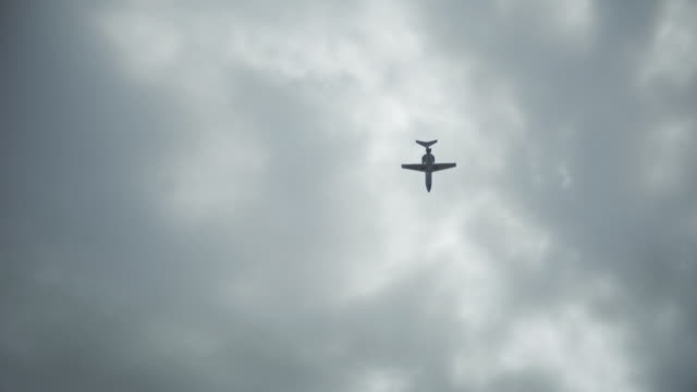Private jet passing by in a cloudy sky