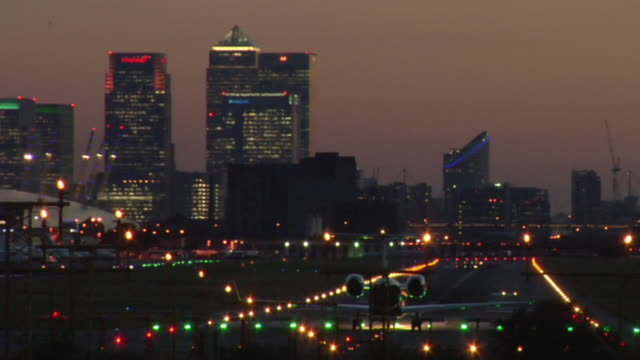 WS, Private jet taking off from City Airport at dusk, London, England