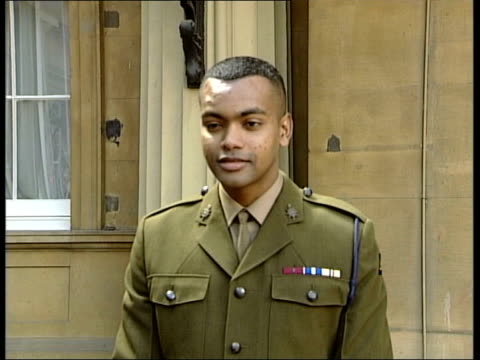 private johnson beharry receives victoria cross private johnson beharry vc statement to press sot people helped me i didn't do it by myself/ i'm... - the victoria cross stock-videos und b-roll-filmmaterial