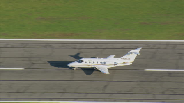 AERIAL Private light plane taking off at regional airport / New Bedford, Massachusetts, United States
