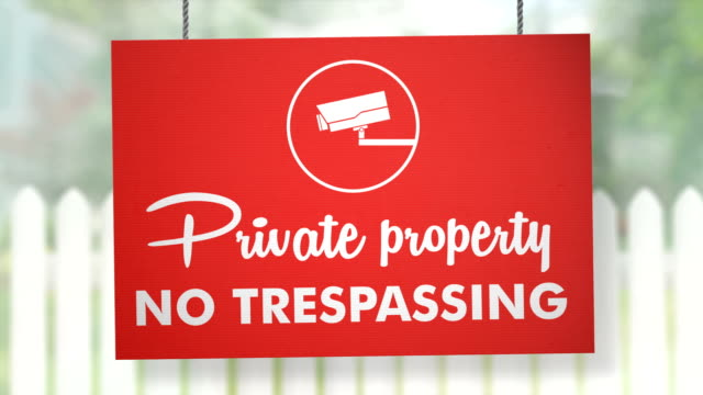 private property no trespassing sign hanging from ropes. luma matte included so you can put your own background. - no trespassing stock videos & royalty-free footage