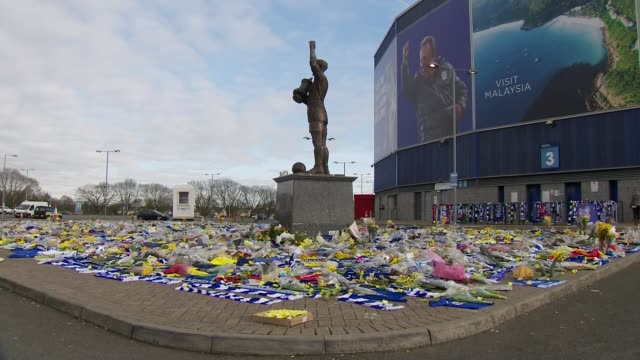 Private search for plane of missing footballer Emiliano Sala begins WALES Cardiff Cardiff City Stadium EXT Floral tributes outside stadium Tributes...