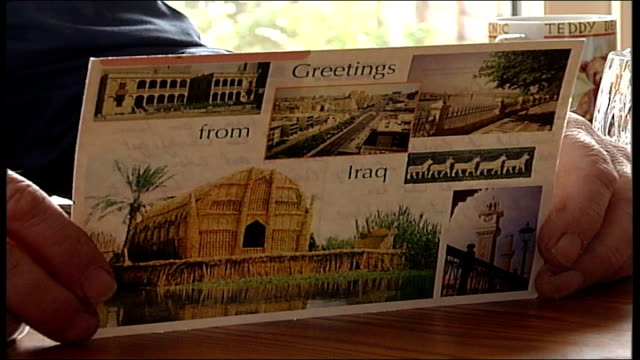 700 killed since fall of saddam hussein england int **music and voice reading postcard overlaid on following shots sot** hands holding postcard... - postcard stock videos and b-roll footage