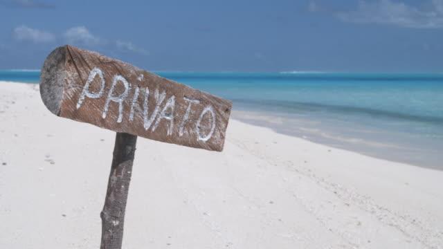 MS 'Privato' sign on tropical deserted beach, Bora Bora, Society Islands, French Polynesia