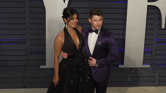 priyanka chopra and nick jonas at 2019 vanity fair oscar party hosted by radhika jones at wallis annenberg center for the performing arts on february... - vanity fair oscar party stock videos & royalty-free footage