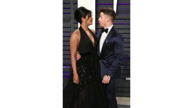 priyanka chopra and nick jonas attend 2019 vanity fair oscar party hosted by radhika jones at wallis annenberg center for the performing arts on... - vanity fair video stock e b–roll