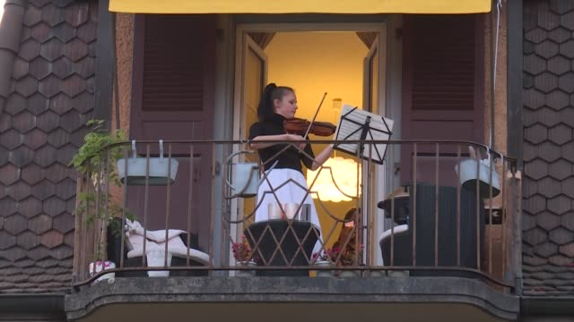 prize-winner at international competitions, moldavan violinist alexandra conunova plays a concert from her balcony for her neighbours in lausanne,... - balcony stock videos & royalty-free footage