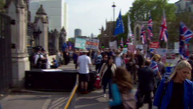 pro- and anti-brexit protesters demonstrating outside the houses of parliament - 2016 european union referendum stock videos & royalty-free footage