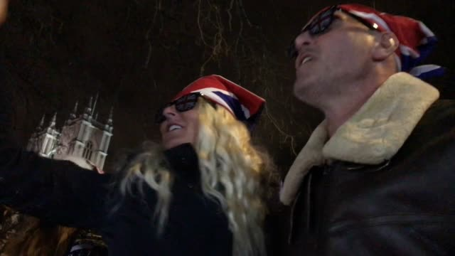 pro brexit supporters wearing union jack sunglasses sing and dance to tom jones it's not unusual as they celebrate leaving the eu at the brexit day... - sunglasses stock videos & royalty-free footage