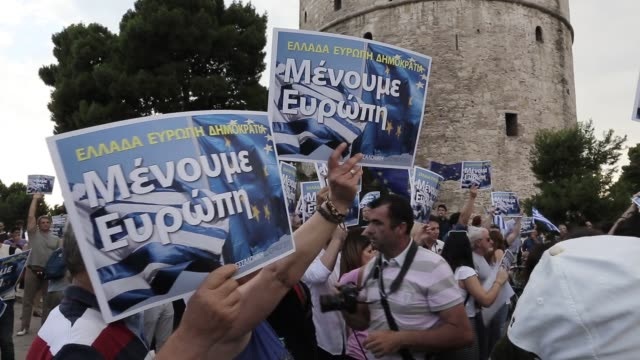 pro european demonstration in front of the city's landmark the white tower in thessaloniki greece on june 22 2015 shots protesters wave flags and... - ユーロ圏債務危機点の映像素材/bロール