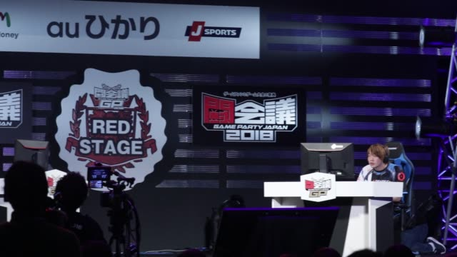 Pro gamers play Capcom Co's Street Fighter game during the Tokaigi Game Party Japan esports competition at the Makuhari Messe convention center in...