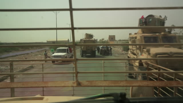 Pro government troops military vehicles travelling through Hudaydah in Yemen