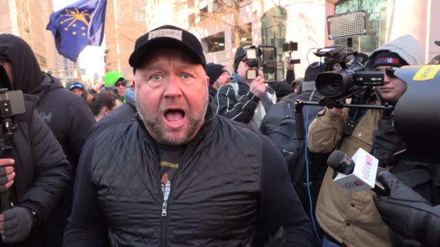 pro gun rights activists rally against gun control legislation in richmond right wing radio personality and conspiracy theorist alex jones makes way... - paranoia stock videos & royalty-free footage