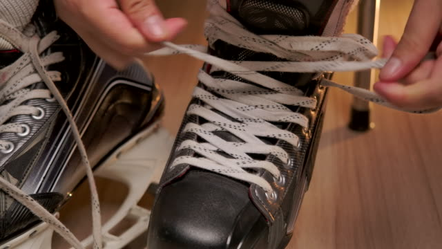 pro ice hockey shoe stringer. - hockey glove stock videos & royalty-free footage