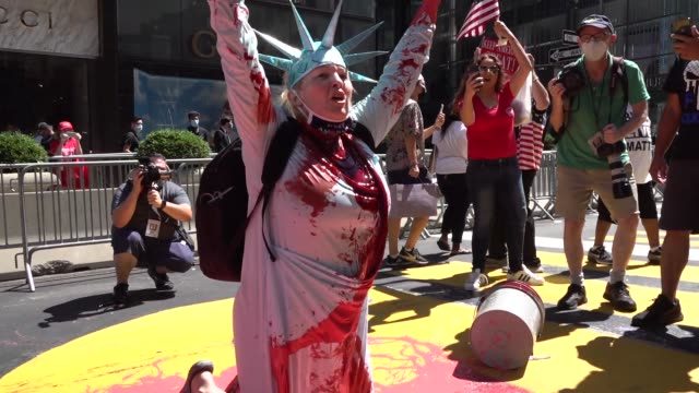 pro trump activist juliet germonatta throws paint in her 'operation paint drop' protests vandalizing black lives matter mural in front of trump tower... - 公共物破壊点の映像素材/bロール