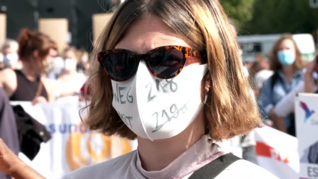 proabortion protester wearing a protective face mask that reads 'abolish article 218' demonstrates in front of brandenburg gate during a... - weg stock videos & royalty-free footage