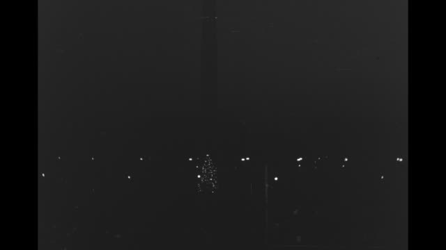 vídeos y material grabado en eventos de stock de [probably christmas eve 12/24/41] lighted christmas tree on the ellipse with white house south portico in background / crowd on lawn outside south... - 1941