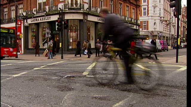 problem of potholes in london t23030703 / tx cyclist riding over uneven road surface - uneven stock videos & royalty-free footage