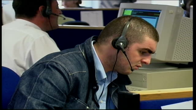 Problems Telephone helpline swamped with calls ITN ENGLAND Manchester Broadsystem Census Helpline Staff working in call centre MCUS Staff wearing...