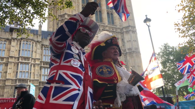 pro-brexit activist joseph afrane stands with town crier tony appleton outside the houses of parliament on what would have been the day that the... - 2016 european union referendum stock videos & royalty-free footage