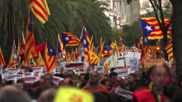 ProCatalan independence supporters marching through the streets of Barcelona