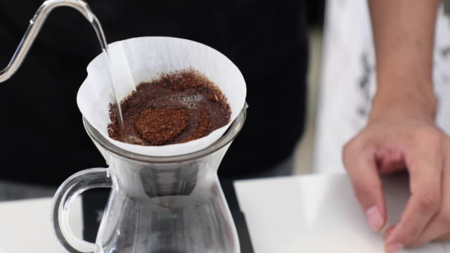 Process of coffee drip with vintage equipment and hot water