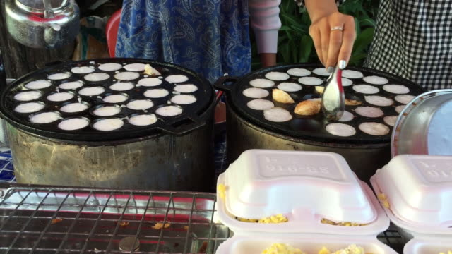 process of cooking sweet and savory grilled coconut-rice hotcakes - savory food stock videos & royalty-free footage