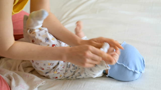 process of dressing little baby - changing nappy stock videos & royalty-free footage