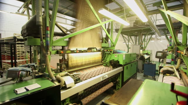ws process of manufacturing textile at camira fabrics moquette factory / lithuania - 織物工場点の映像素材/bロール