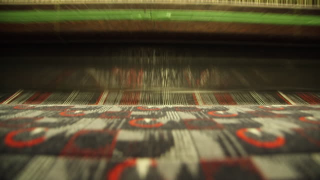 ms process of manufacturing textile at camira fabrics moquette factory / lithuania - 織物工場点の映像素材/bロール