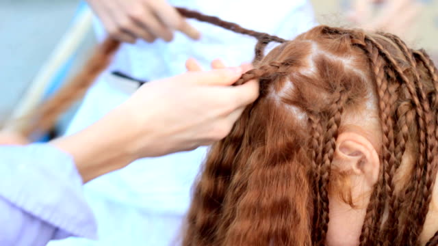 process of unbraid braids on red-haired teenage girl - curly stock videos & royalty-free footage