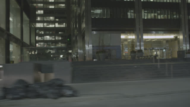 process plate 3/4 back left of car driving on city street in toronto. office buildings, pedestrians, businesses, and garbage bags visible. - driving plate stock videos & royalty-free footage