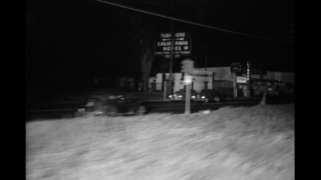 process plate night shot from railroad tracks in industrial area northwest of downtown los angeles probably along san fernando road / train passes... - burbank stock-videos und b-roll-filmmaterial