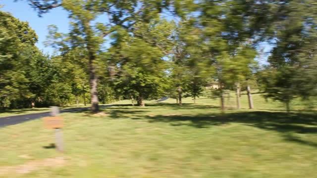 vídeos de stock, filmes e b-roll de process plate of rural area. fields, farmlands, and woods visible. cemetery visible. - stationary process plate