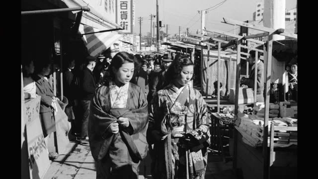 process plate traveling down busy sidewalks of tokyo passes by shops and many pedestrians tokyo scenes on january 01 1948 in japan - 戦後点の映像素材/bロール