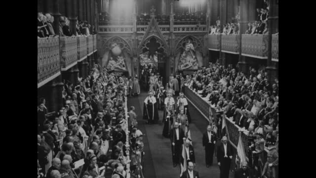 procession at queen elizabeth ii's 1953 coronation ceremony exits the coronation theater at westminster abbey which includes prime minister winston... - archbishop of canterbury stock videos & royalty-free footage