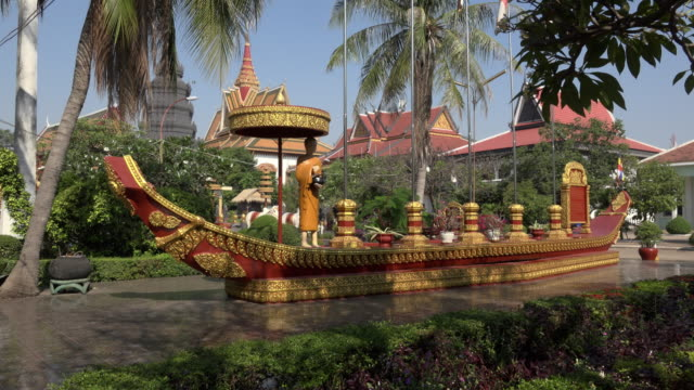 pan / procession boat in wat preah prom rath temple in siem reap - cambodia stock videos and b-roll footage