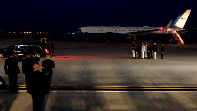 A procession follows the hearse that carries the casket of US Sen John McCain leave Joint Base Andrews August 30 2018 in Maryland The late senator...