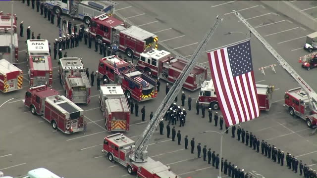 ktla a procession is underway ahead of a memorial service for a fallen long beach fire department captain who was killed in the line of duty in an... - police line up stock videos and b-roll footage