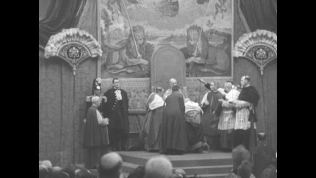 ms procession of cardinals toward camera in st peter's basilica and to standing positions / ms cardinal james mcintyre kneeling in front of pope pius... - cardinal clergy stock videos and b-roll footage