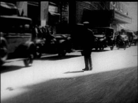 procession of cars on city street at rudolph valentino's funeral / nyc / newsreel - 1926 stock videos & royalty-free footage
